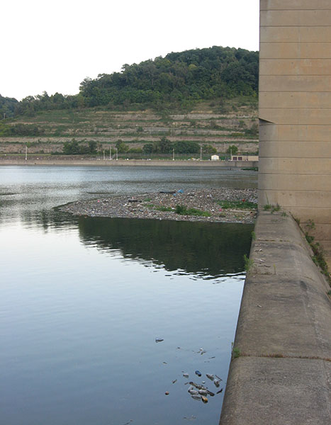 reflections in back of the dam
